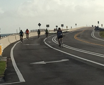 Ride to Keys 2019 fourth day group riding off of the 7 mile bridge for the second time