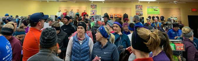 Saturday gathering prior to our run. About 200 runners. We are on the 1/2 marathon side and the wall we are looking at has the full marathon runners.