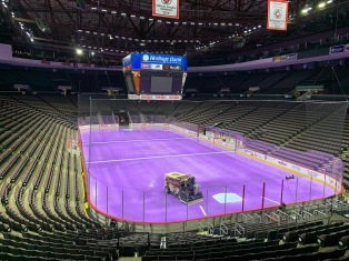 Zamboni Machine on the ice--Purple ice for a special cancer awareness game that evening